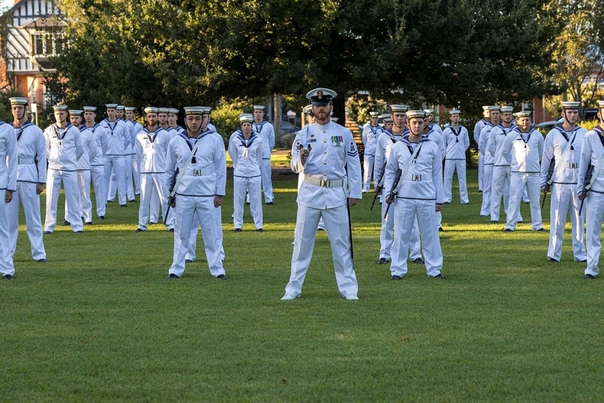 Petty Officer Alexander Wilson leads the Navy parade during a colours ceremony held at RAAF Base Wagga to mark Navy's 120th birthday.