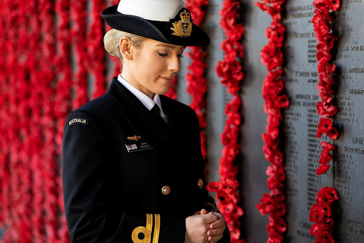 Lieutenant Sarah Rohweder reflects in front of the Roll of Honour at the Australian War Memorial in Canberra. Photo: Leading Seaman Kayla Jackson