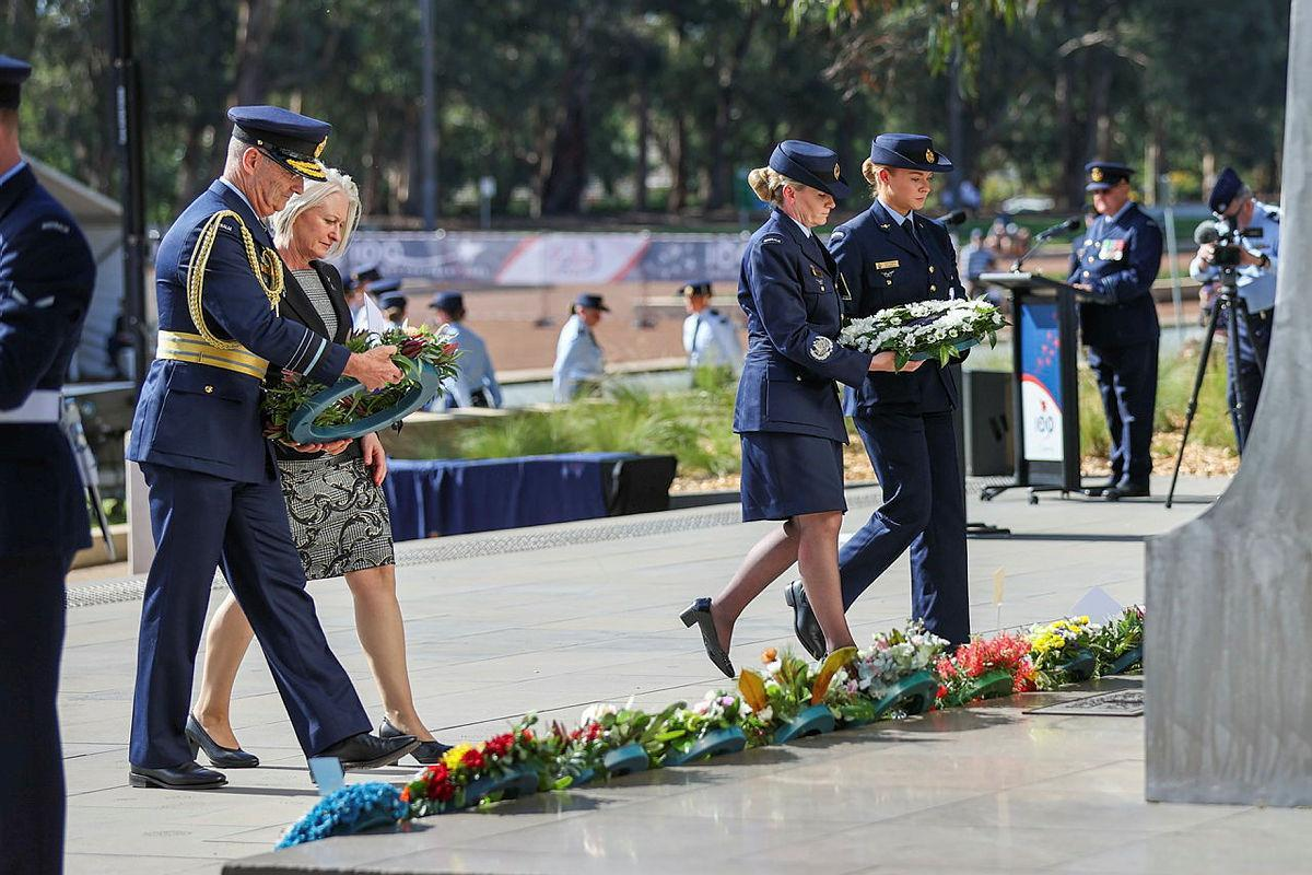 Chief of Air Force Air Marshal Mel Hupfeld, left, his wife Louise Hupfeld, Warrant Officer of the Air Force Fiona Grasby, and Leading Aircraftwoman Victoria Farell lay wreaths at the Air Force memorial. Photo: Leading Aircraftwoman Jacqueline Forrester