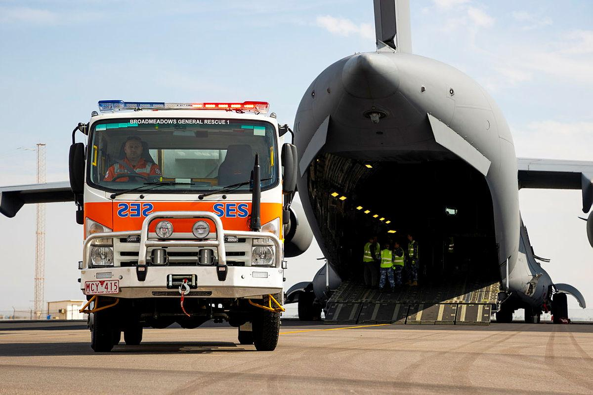 A Victorian State Emergency Service is driven off an Air Force C-17A Globemaster III aircraft, after being delivered from to Geraldton in Western Australia from Melbourne. Photo: Leading Seaman Kieren Whiteley