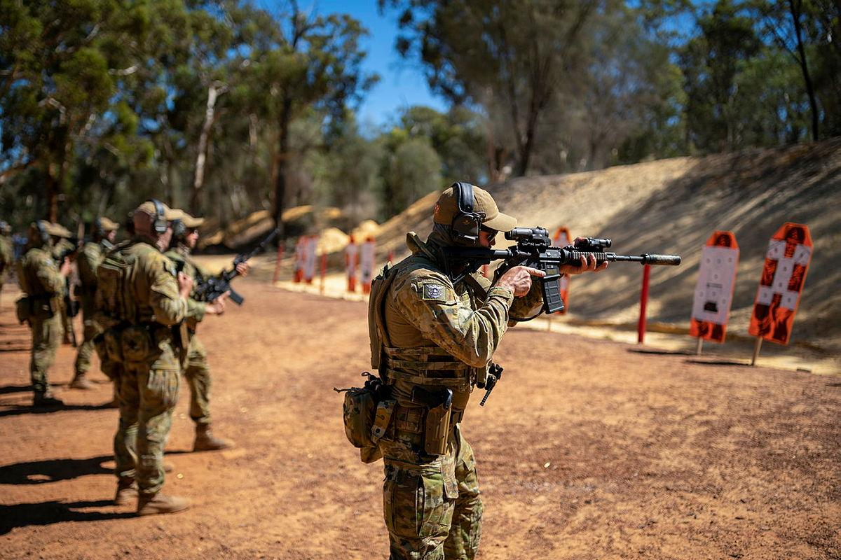 Officers and soldiers from 11/28th Battalion, Royal Western Australia Regiment and Clearance Divers from Australian Clearance Diving Team - Four fire at targets as part of an enhanced combat shooting exercise. Photo: Leading Seaman Ronnie Baltoft