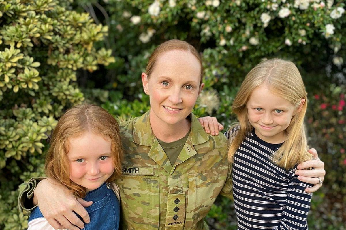 Captain Leigh Smith, a public affairs officer in the Army Reserve, with her daughters.