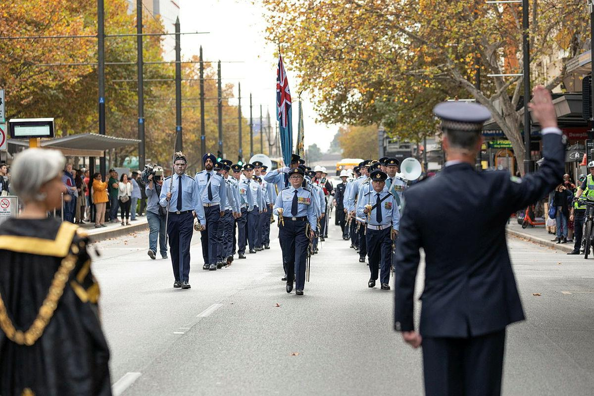 South Australian Police Chief Superintendant Stuart McLean challenges No. 24 (City of Adelaide) Squadron during a march along King William Street to Adelaide Town Hall. Photo: Leading Aircraftman Sam Price