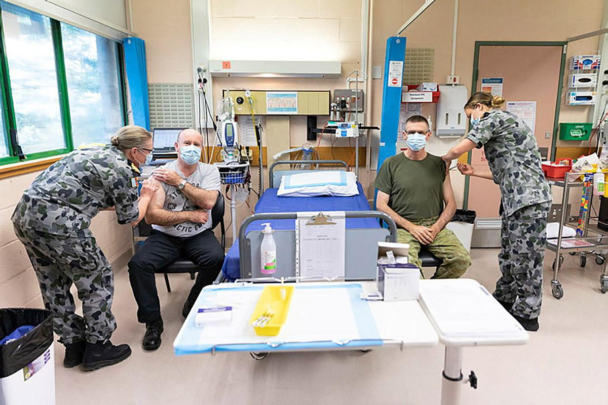 Defence Secretary Greg Moriarty and Chief of the Defence Force General Angus Campbell receive their first dose of the AstraZeneca COVID-19 vaccine at the Duntroon Health Centre, Canberra. Photo: Jay Cronan