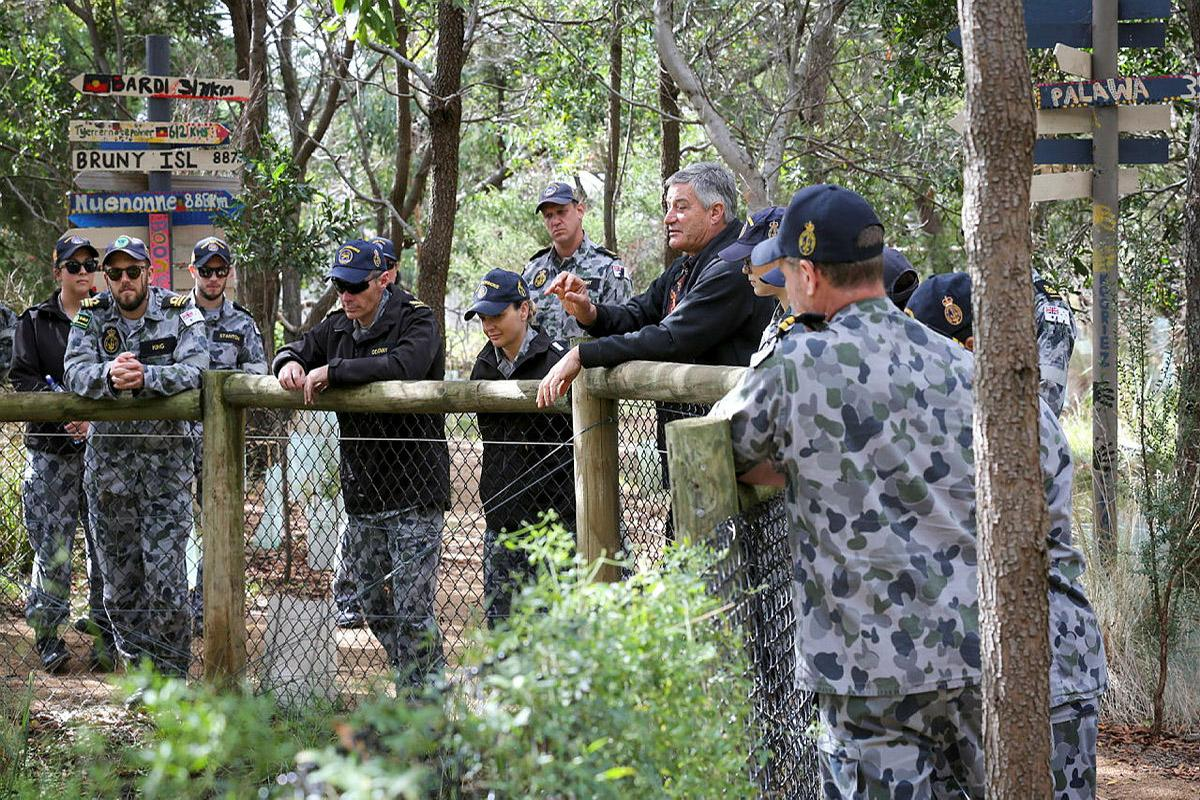 Willum Warrain Aboriginal Association executive officer Peter Aldenhoven, centre, takes maritime human resources officer course members on a tour of the Koorie bush tucker trail, during their visit to the association. Photo: Leading Seaman James McDougall