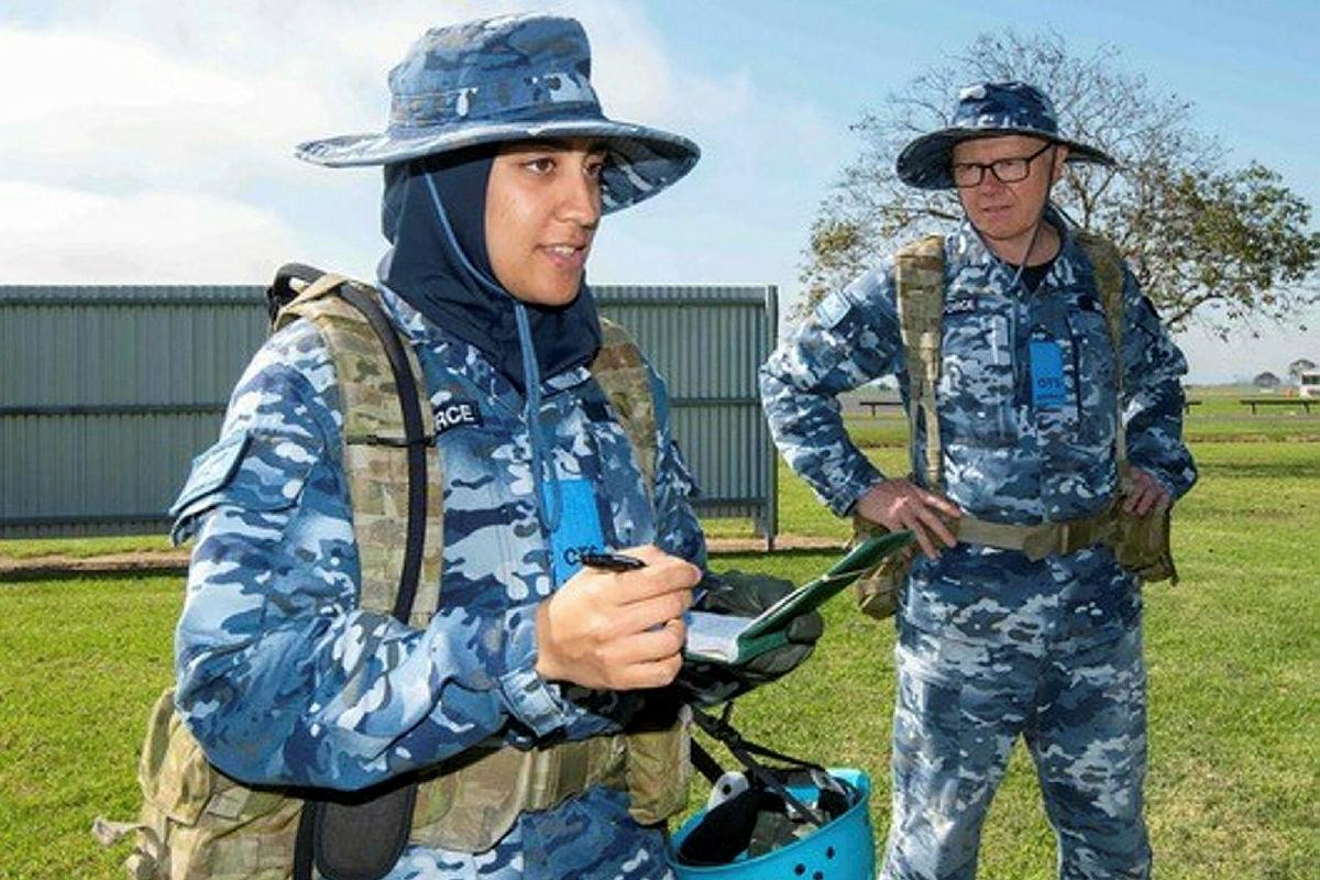 Flying Officer Ayah Khalid, left, with Leadership Reaction Course team member Flying Officer Clayton Wilson during a course at Officer Training School at RAAF Base East Sale. Photo: Flight Sergeant Scott Robbins