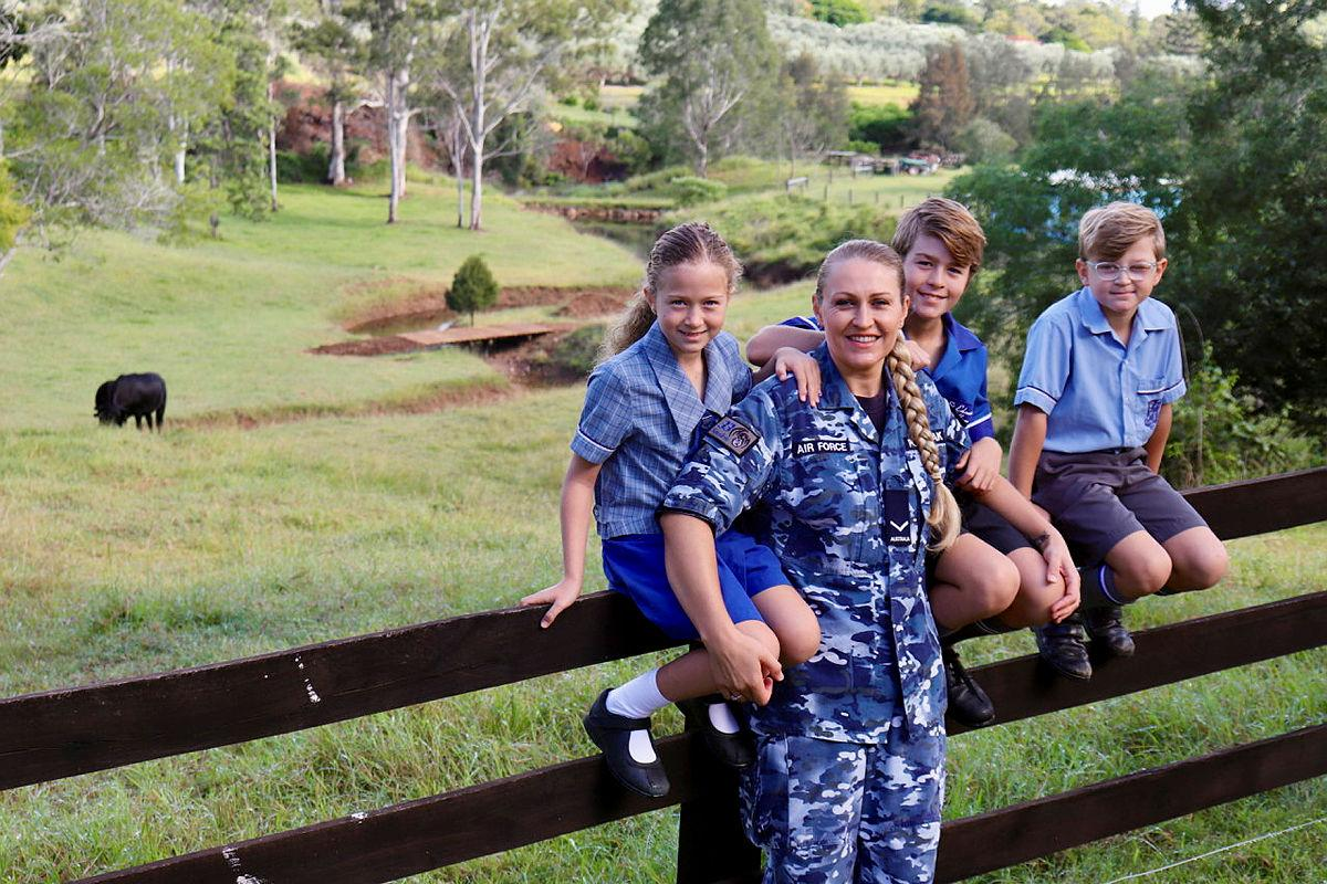 Leading Aircraftwoman Svitlana Pogrebnyak with her three children Christopher, centre, and twins Sophie and Matthew on their family property near RAAF Base Amberley in Queensland.