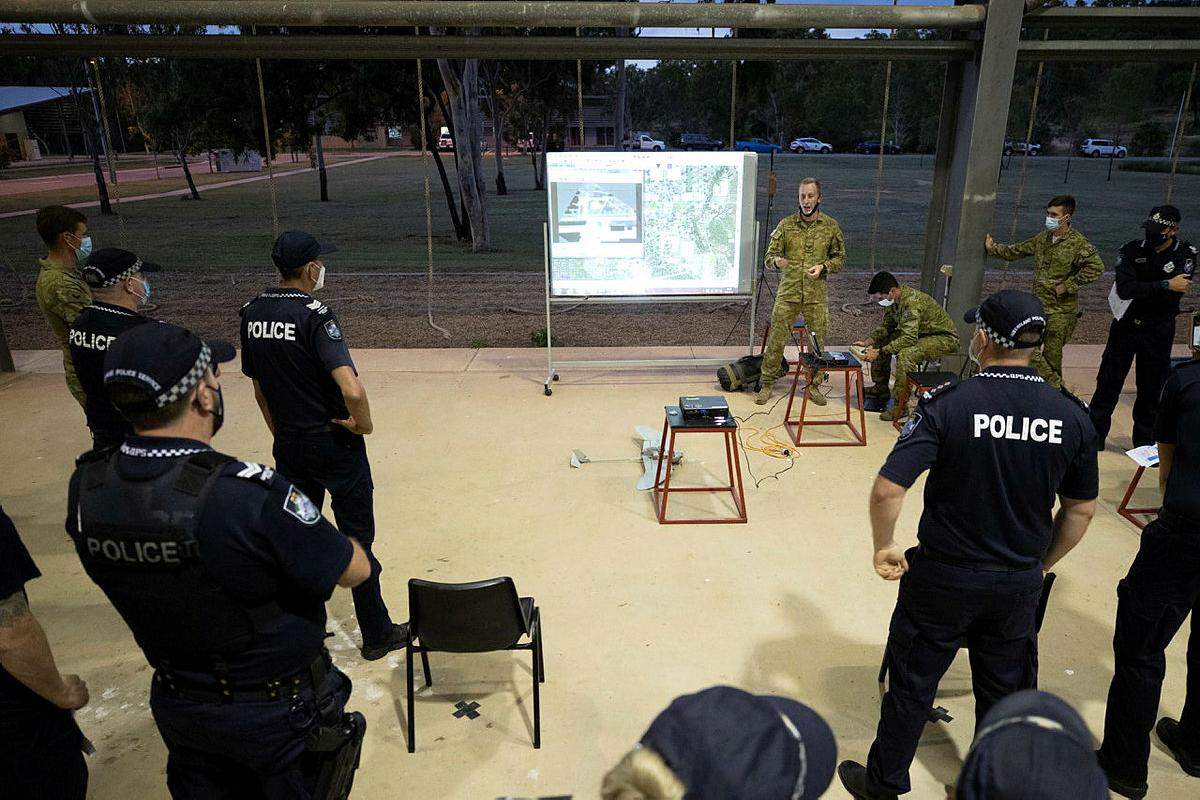 Corporal Ryan Waterham, from the 3rd Battalion, Royal Australian Regiment, demonstrates the unit's unmanned aerial system to Queensland Police officers at Lavarack Barracks, Photo: Corporal Brandon Grey