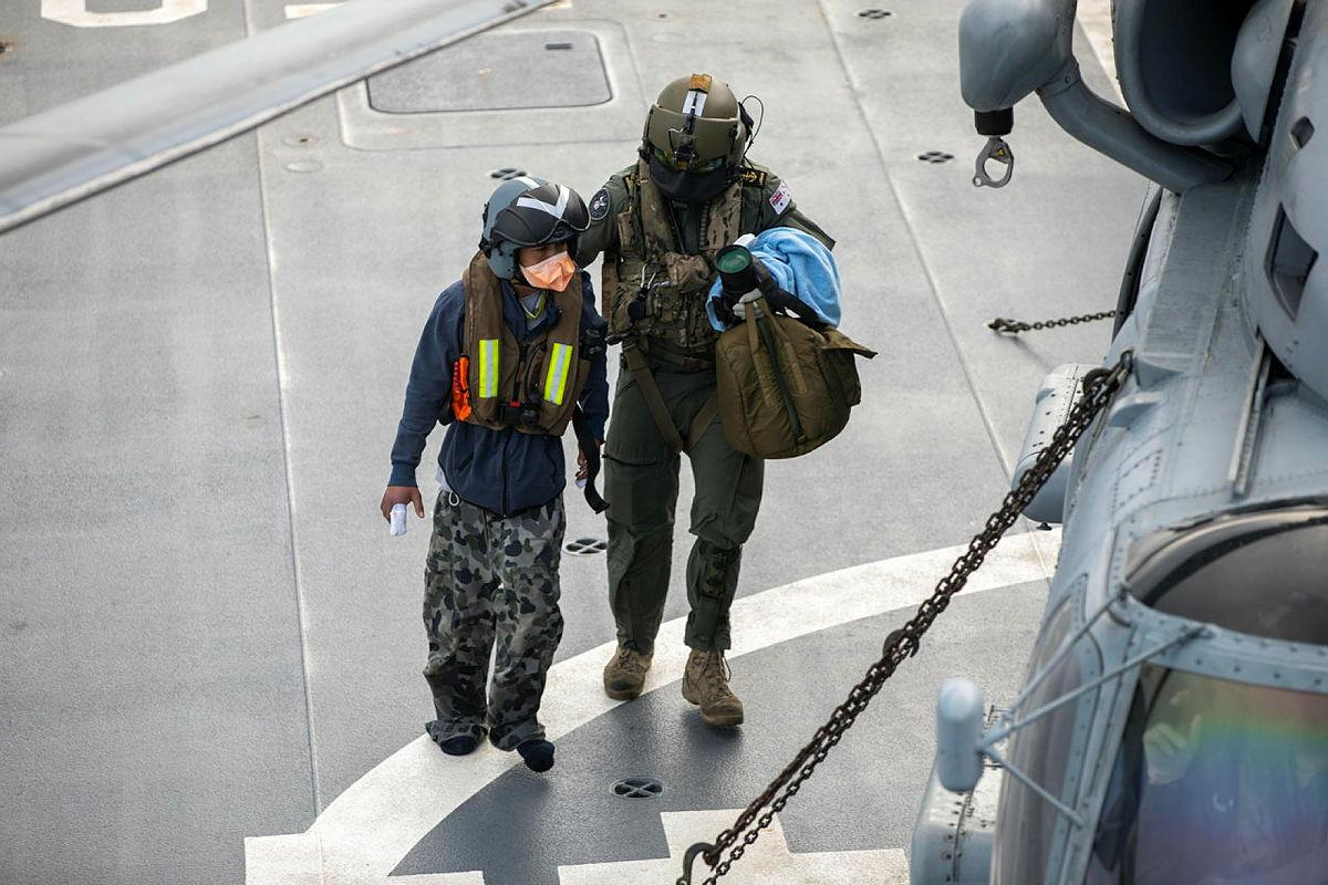 An Indonesian fisherman rescued in the Indian Ocean is airlifted to Perth from HMAS Anzac in the ship's embarked MH-60R helicopter. Photo: Leading Seaman Thomas Sawtell