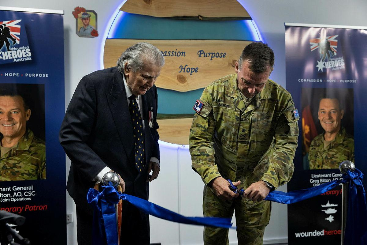 Founder of Wounded Heroes Australia Jim Shapcott, left, with Chief of Joint Operations Lieutenant General Greg Bilton cutting the ribbon to open Wounded Heroes Australia Veterans Lounge at Alderley, Brisbane. Photo: Corporal Nicole Dorrett