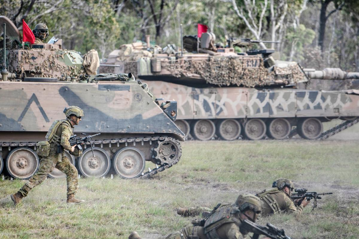 Soldiers from 6th Battalion, Royal Australian Regiment, conduct a live-fire offensive operation serial with support from 2nd/14th Light Horse Regiment (Queensland Mounted Infantry) and 2nd Combat Engineer Regiment. Photo: Private Jacob Hilton