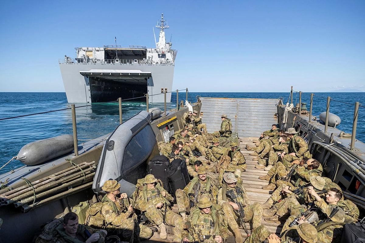 Soldiers from the 2nd Battalion, Royal Australian Regiment, on board an Australian Army LCM-8 landing craft depart HMAS Canberra for beach landing serials during Exercise Sea Explorer. Photo: Leading Aircraftwoman Jacqueline Forrester