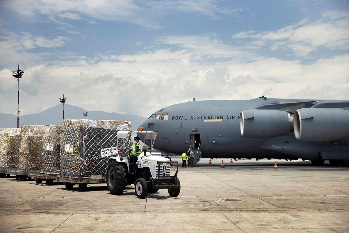 A delivery of humanitarian aid supplies from Western Australia, transported by a RAAF Force C-17A Globemaster III is received at Tribhuvan International Airport in Nepal. Photo: Corporal Robert Whitmore