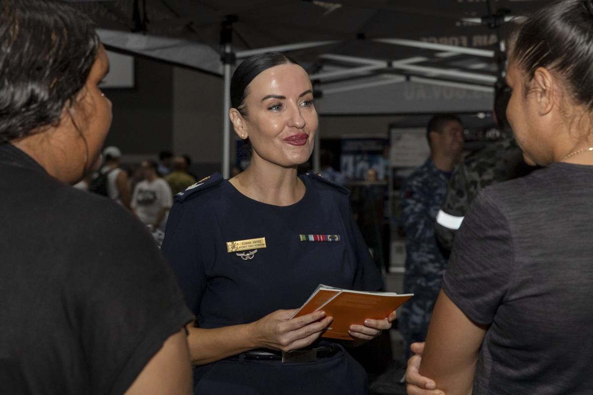 Defence Force Recruiting specialist, Sergeant Donna Hayes talks with two women about a career in the Defence Force during the Women in Defence Careers Expo. Photo Jacob Joseph