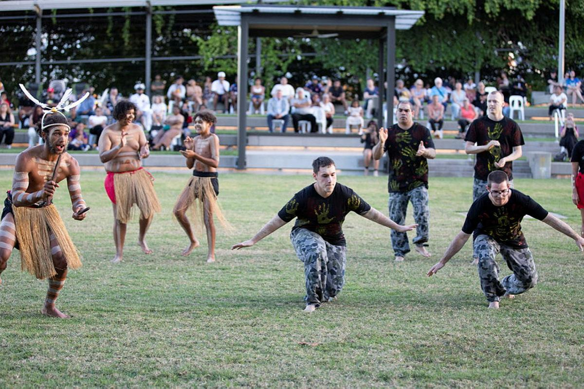 Navy Indigenous Development Program graduates perform a cultural dance with the Buri Guman Aboriginal Dance Group during their graduation in Cairns. Photo: Petty Officer Bradley Darvill