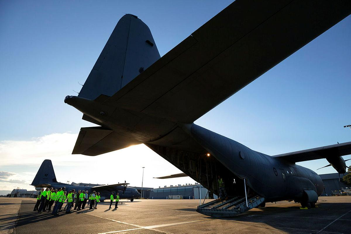 Quickstep Aerospace Services employees are given a tour of a No. 37 Squadron C-130J Hercules during a visit to RAAF Base Richmond. Photo: Corporal David Said