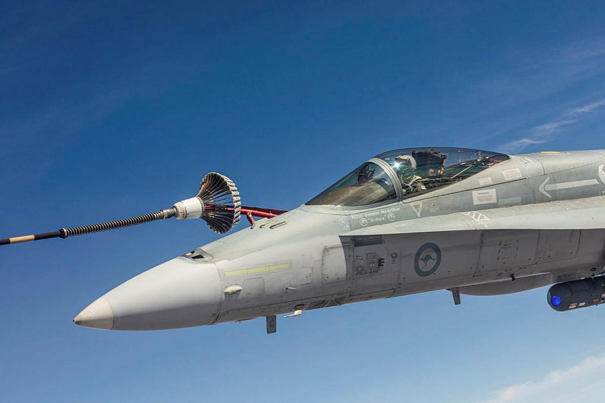 F/A-18A Hornet A21-008 refuels in the air over the Northern Territory during Exercise Arnhem Thunder. Photo: Leading Aircraftman Stewart Gould