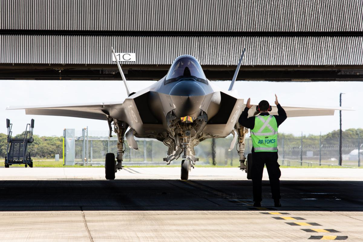 A pilot is marshalled in after completing his first flight in an F-35A Lightning II during the Operational Conversion course at RAAF Base Williamtown. Photo: Sergeant Guy Young