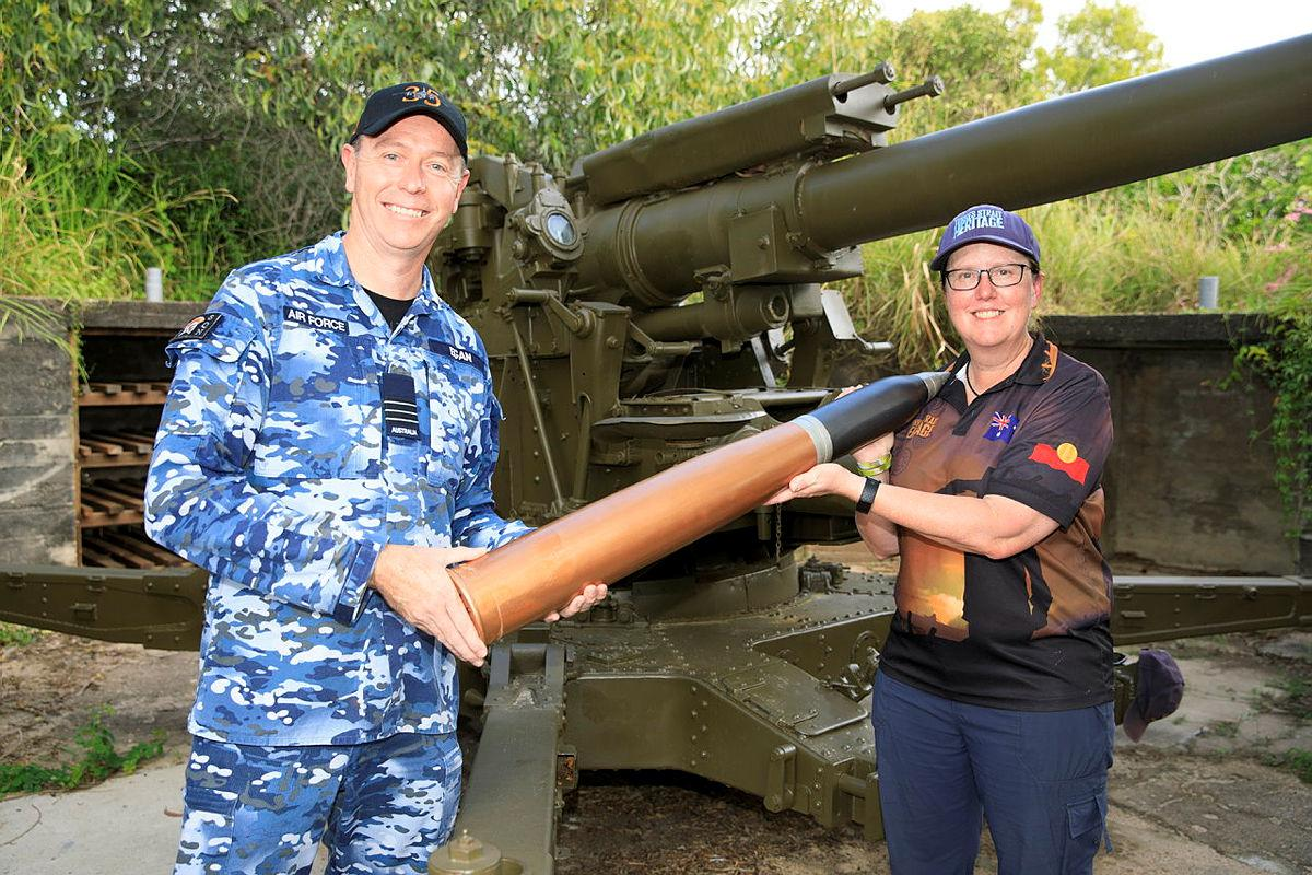Commanding Officer No. 35 Squadron Wing Commander Scott Egan presents the curator of the Torres Strait Heritage Museum, Vanessa Seekee, with a replica 3.7-inch shell. Photo: Corporal Brett Sherriff