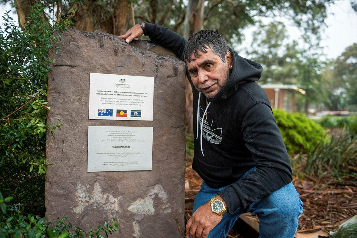 Elder Uncle Ringo Terrick, of the Wurundjeri people, next to the Acknowledgement of Country plaque at Simpson Barracks, Melbourne. Photo: Private Michael Currie