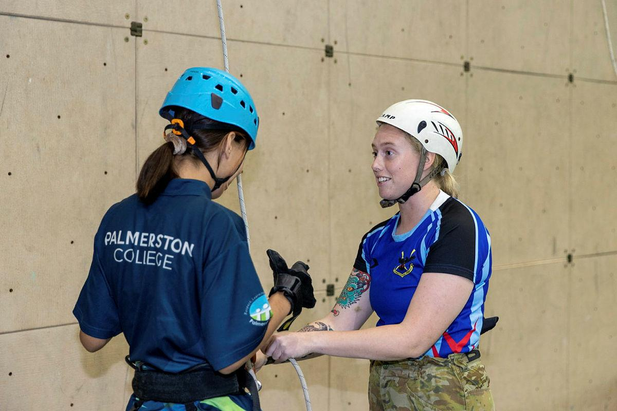 Signaller Catherine Welsh, right, from the 1st Combat Signal Regiment, with a young Indigenous woman from the Stars Foundation after an abseiling run at Robertson Barracks. Photo: Corporal Rodrigo Villablanca