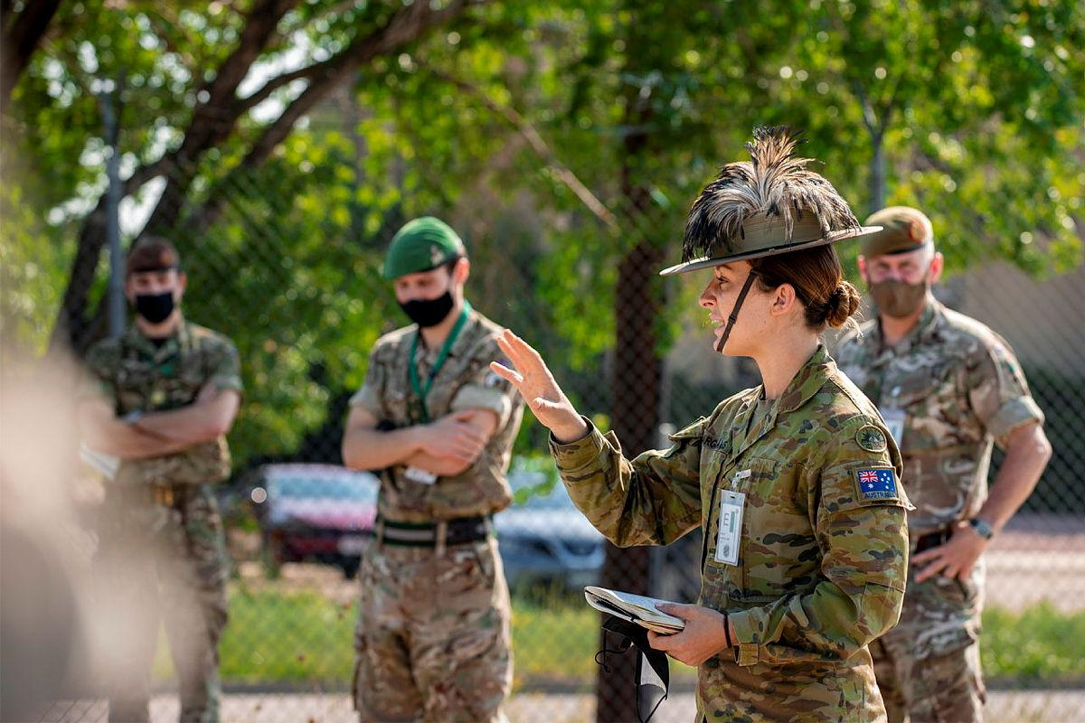 Captain Charlotte Hargreaves, of the 7th Combat Brigade, gives orders to members from the Australian Army, US Army and Canadian Armed Forces during the Joint Warfighting Assessment 2021 at Fort Carson, Colorado. Photo: Corporal Nicole Dorrett