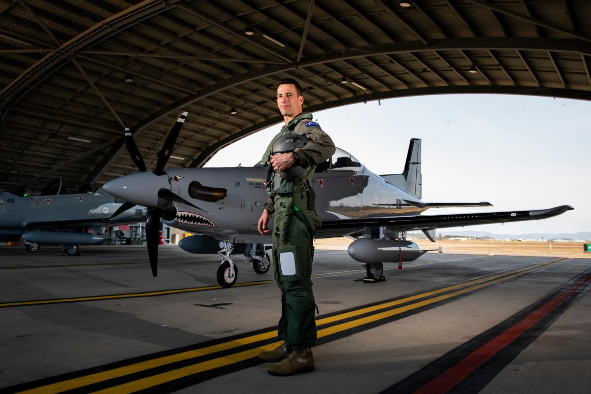 Australian Army pilot Captain David Fileman, from No. 4 Squadron, with a PC-21 aircraft during TS21, at RAAF Base Townsville, Qld. Photo: LACW Emma Schwenke