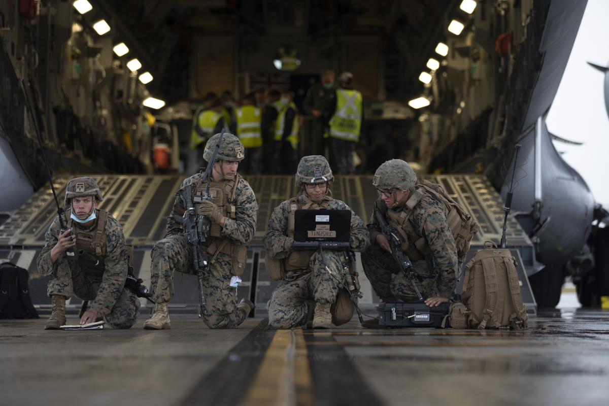 United States Marines conduct a simulated wartime airfield scenario at the rear of a Royal Australian Air Force No. 36 Squadron C-17A Globemaster III aircraft at RAAF Base Amberley, QLD, during Exercise Talisman Sabre 2021. Photo: Corporal Jesse Kane