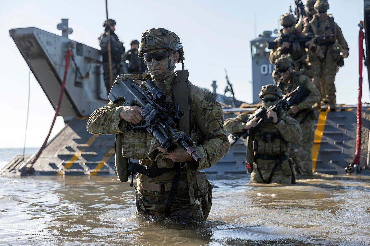 Personnel from the 3rd Battalion Royal Australian Regiment, conduct a beach assault on Forrest Beach, Queensland, during Exercise Talisman Sabre 2021. Photo: Leading Aircraftwoman Jacqueline Forrester