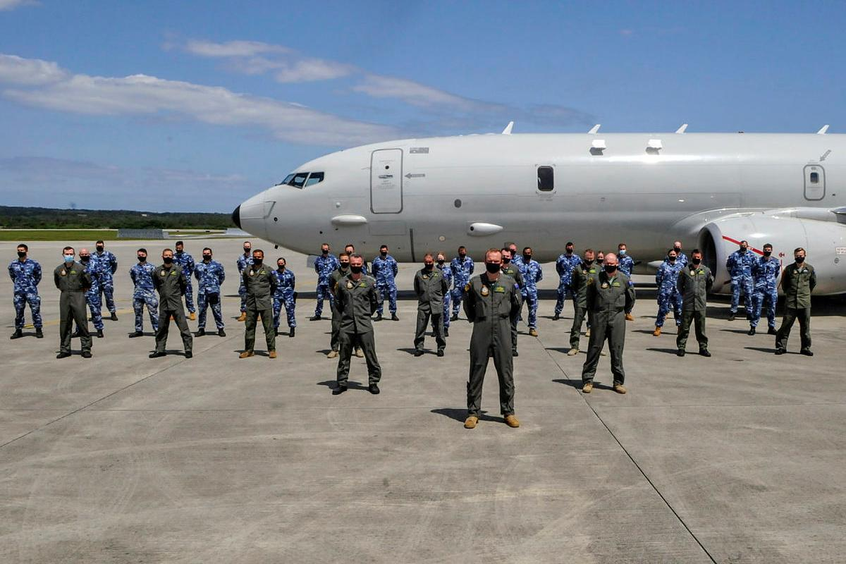No. 11 Squadron personnel in front of an Air Force P-8A Poseidon aircraft at Kadena Air Base in Okinawa, Japan during Operation Argos.
