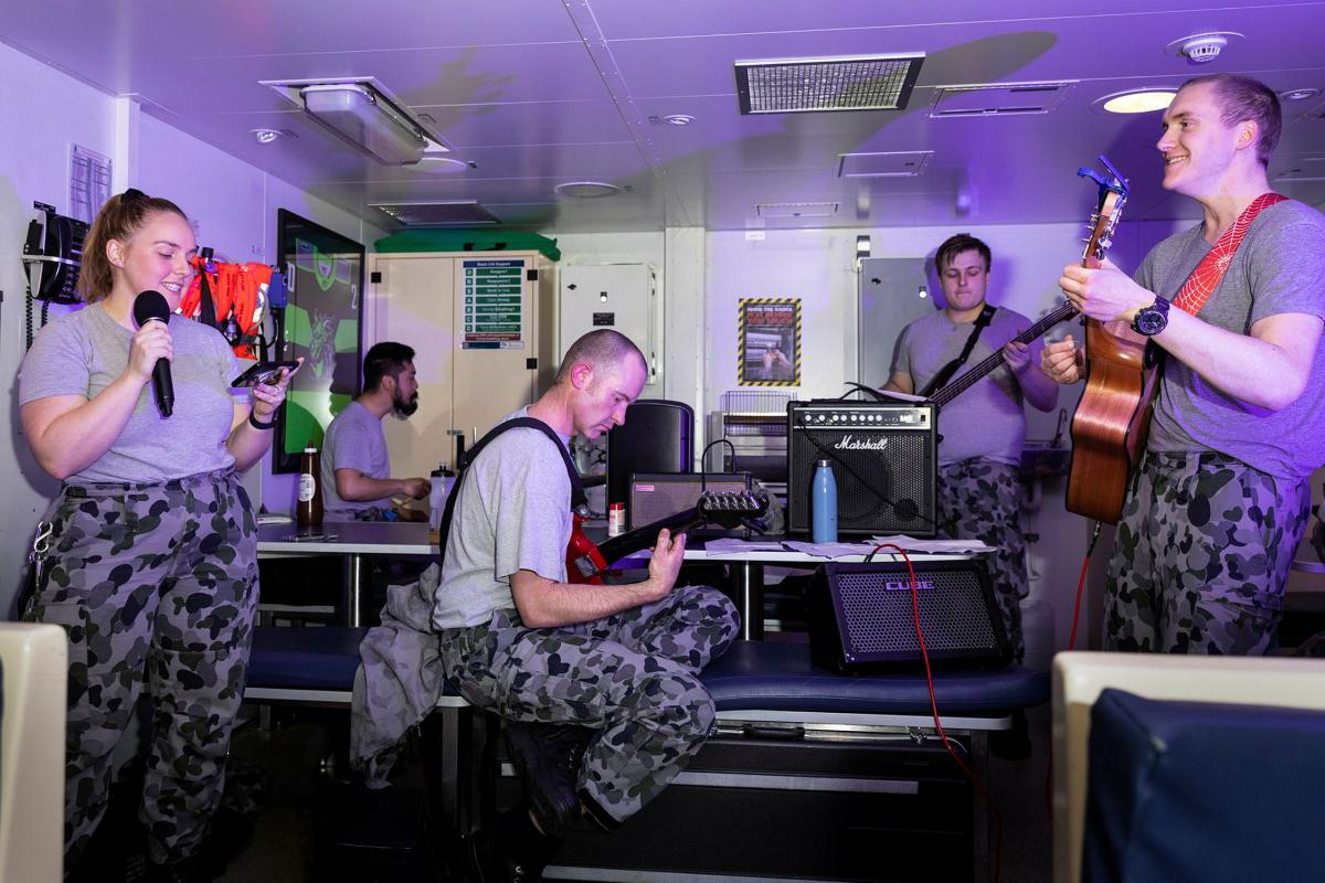 HMAS Brisbane's band, made up of members of the crew, play their first gig together in front of a live audience in the junior sailors' café off the coast of Queensland during Exercise Talisman Sabre. Photo: Leading Seaman Daniel Goodman
