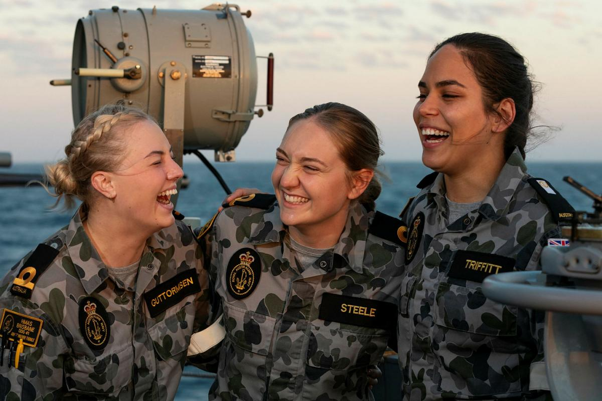 Sub Lieutenants Taylah Guttormsen, left, and Amy Steele and Midshipman Laura Triffitt are completing Phase 2 of their maritime warfare officer course aboard HMAS Brisbane during Exercise Talisman Sabre. Photo: Leading Seaman Daniel Goodman