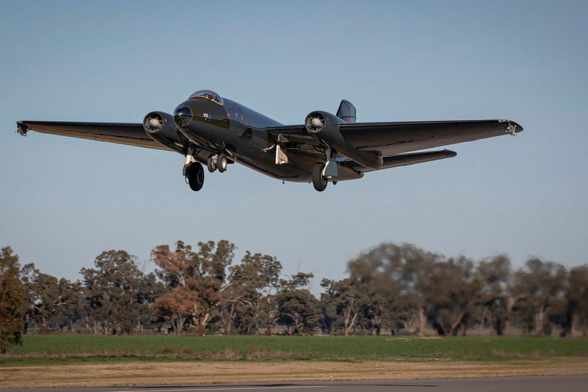 The No. 100 Squadron English Electric Canberra bomber TT heritage aircraft takes off on its maiden flight following restoration at the Temora Aviation Museum.