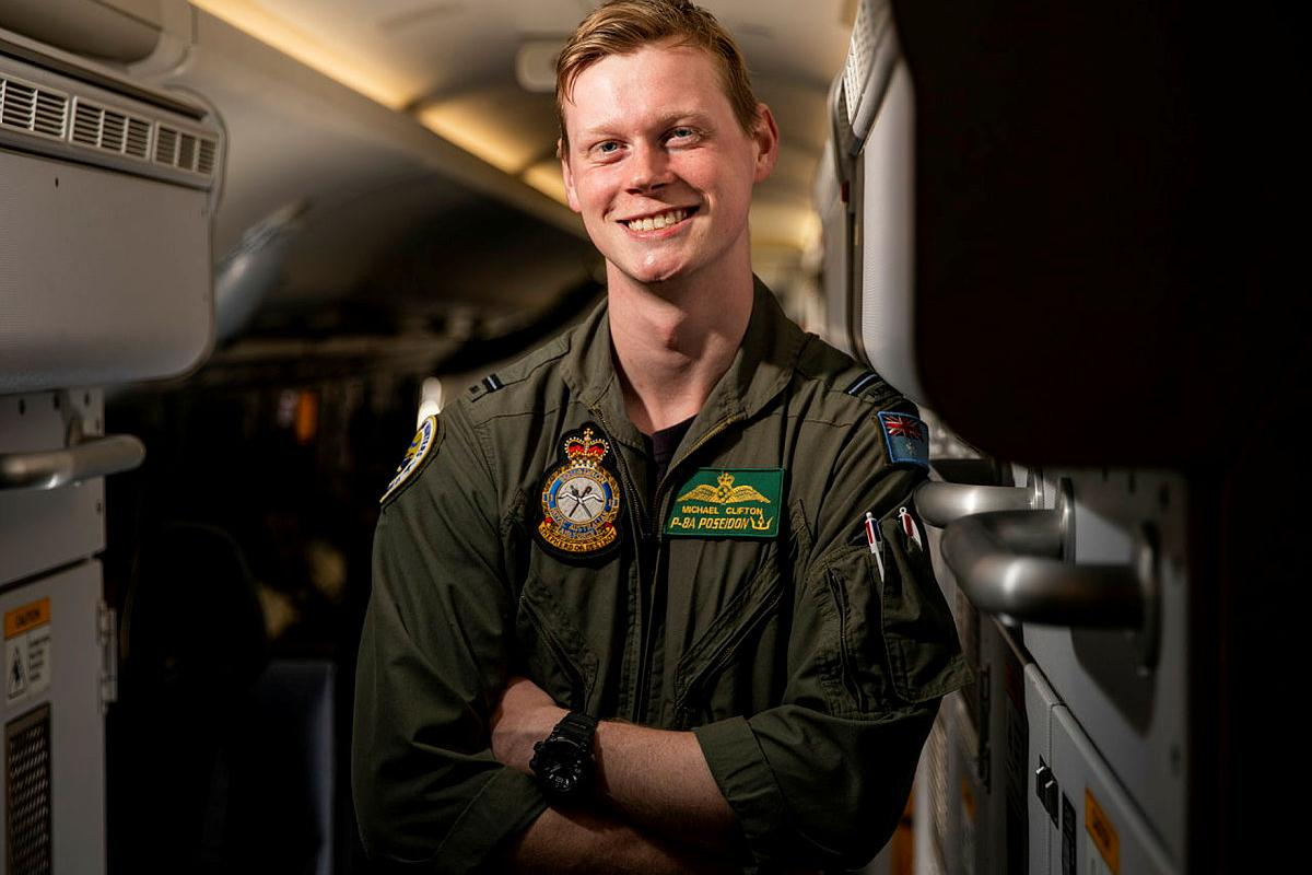 Flying Officer Michael Clifton, a maritime patrol and response officer from No. 11 Squadron, on board a P-8A Poseidon aircraft at RAAF Base Townsville during Exercise Talisman Sabre 2021. Photo: Leading Aircraftwoman Emma Schwenke