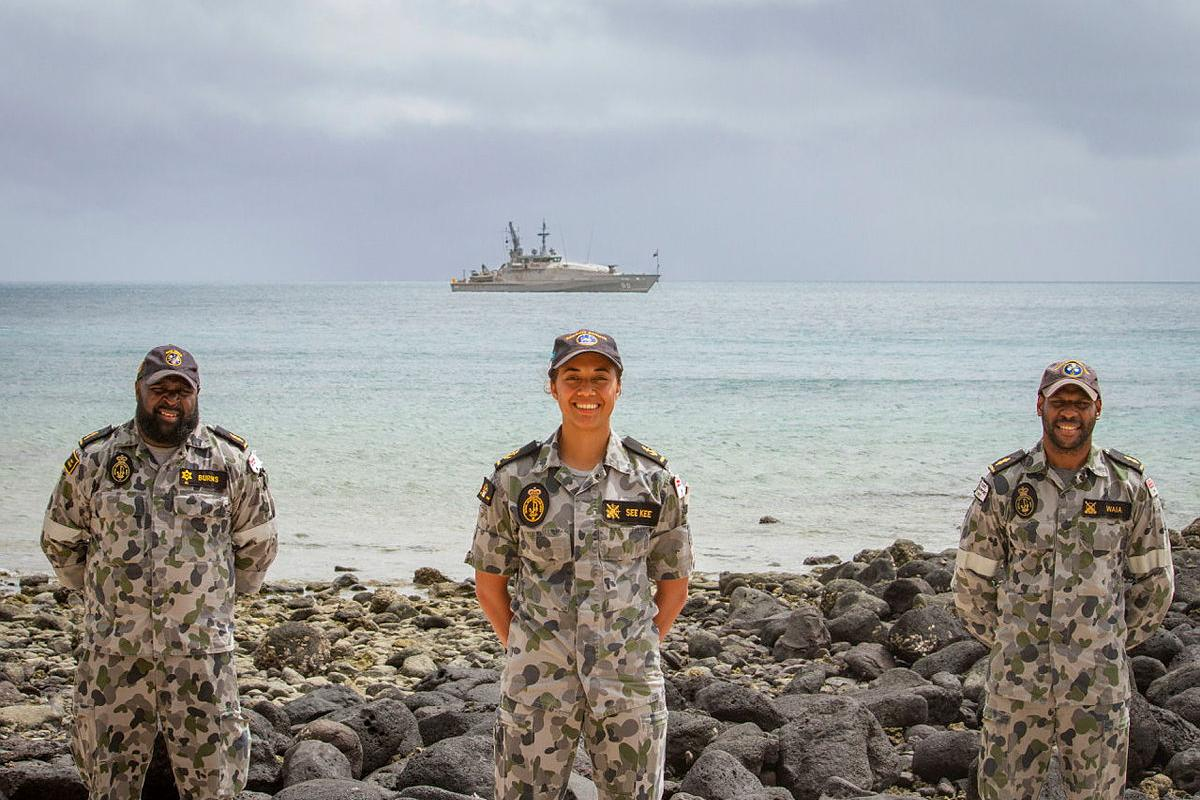 Able Seaman Henry Burns, left, Leading Seaman Monifah See Kee and Able Seaman Terry Waia at a Coming of the Light ceremony in the Torres Straits Islands. Photo: Leading Seaman Breanna Jacobs-Rochford