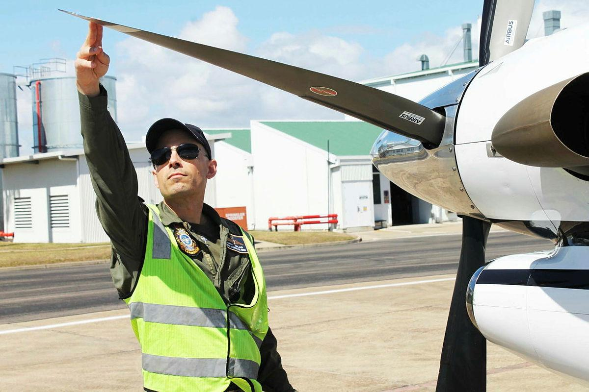 No. 32 Squadron pilot and Detachment Commander Flight Lieutenant Murray Turland performs pre-flight checks on a King Air before a flight in support of Exercise Talisman Sabre.