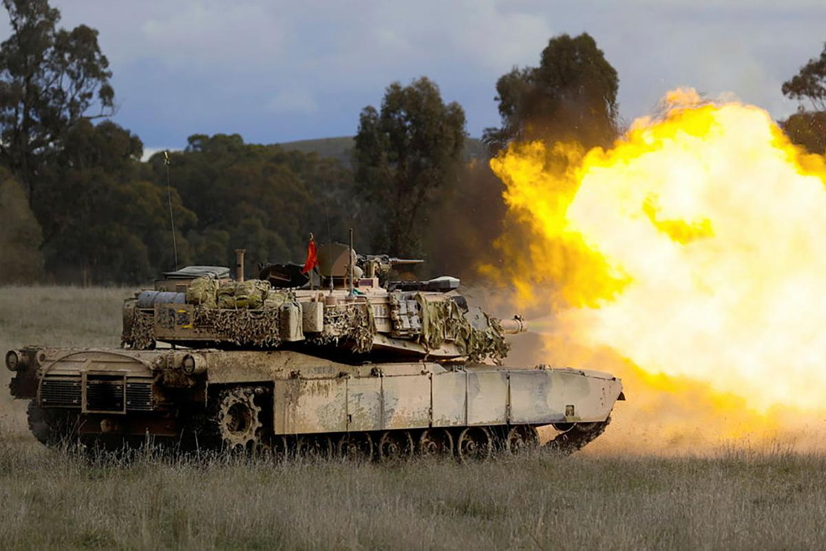 An Australian Army M1A1 Abrams main battle tank fires its main armament during live-fire training for Exercise Gauntlet Strike at Puckapunyal Military Training Area. Photo: Corporal Robert Whitmore