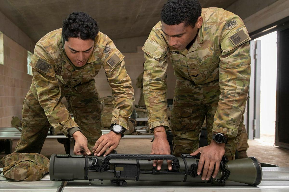 Corporal Steve Tonga, left, and Corporal Paul Tuinanunu, from the 3rd Battalion, Royal Australian Regiment, inspect the Carl Gustaf 84mm Mk4 recoilless rifle after a qualification shoot at the School of Infantry, Singleton. Photo: Private Jacob Joseph