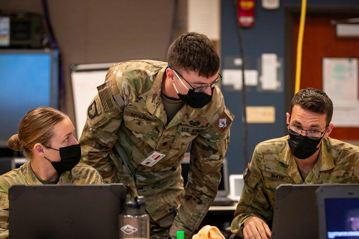 Australian Army Captain Sam Smith, Specialist Tyler Myers, of the US Army, and Private Brook Restall, from 7 Brigade, while deployed on the Joint Warfighting Assessment at Fort Carson, Colorado. Photo: Corporal Nicole Dorrett