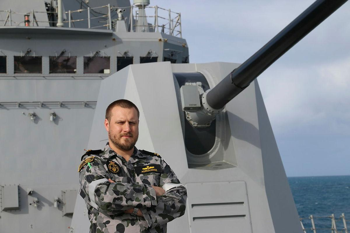 Weapons Electrical Engineering Officer Lieutenant Nick Adriaanse stands on the forecastle of HMAS Brisbane while sailing off the east coast of Queensland.