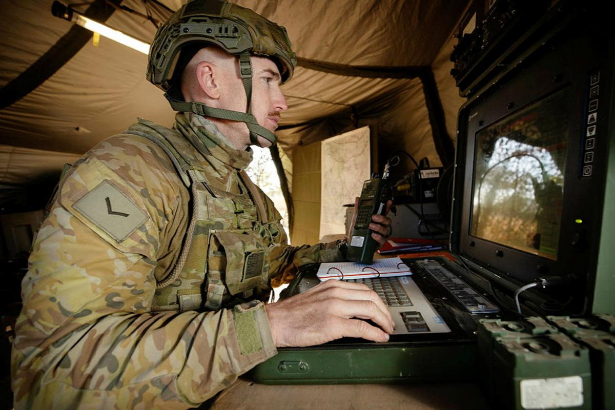 Unmanned aerial vehicle captain Lance Bombardier Lewis Day operates a Shadow 200 from a ground control station during Exercise Dragon Sprint at the Townsville Field Training Area. Photo: Petty Officer Lee-Anne Cooper