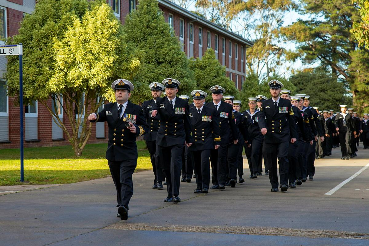 Members of the Defence Force School of Signals - Maritime Wing march through the streets of HMAS Cerberus during celebrations to mark 100 years of communications training. Photo: Petty Officer James Whittle