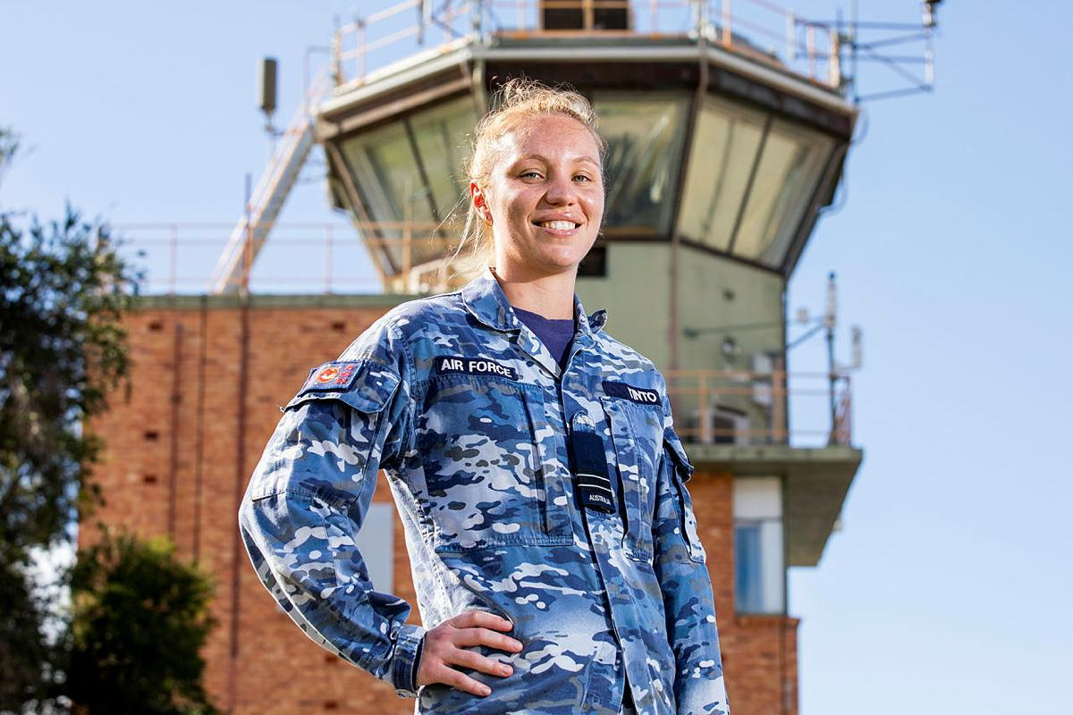 Air traffic controller Flight Lieutenant Amy Tinto, from No. 452 Squadron, in front of the air traffic control tower at RAAF Base Townsville during Exercise Talisman Sabre 2021. Photo: Leading Aircraftwoman Emma Schwenke