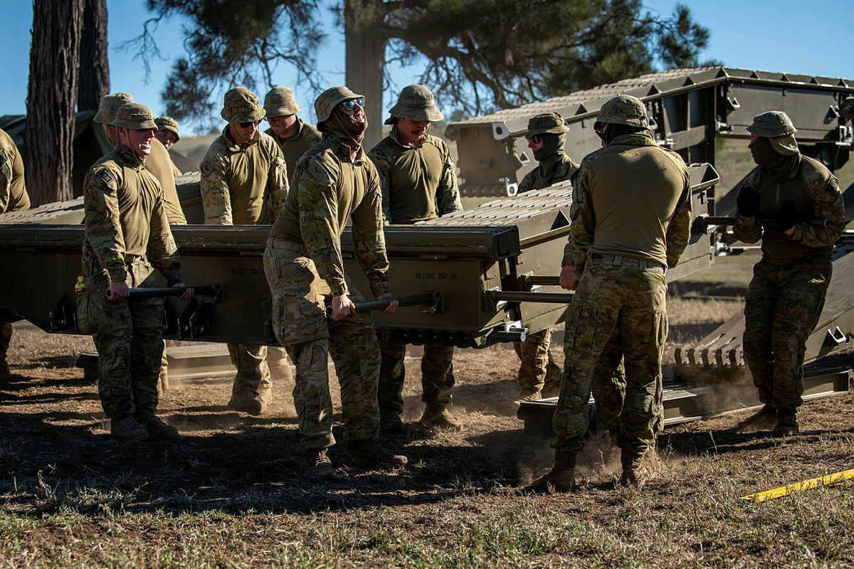 Soldiers from the 2nd Combat Engineer Regiment disassemble a medium girder bridge at Gayndah, Queensland. Photo: Private Jacob Hilton