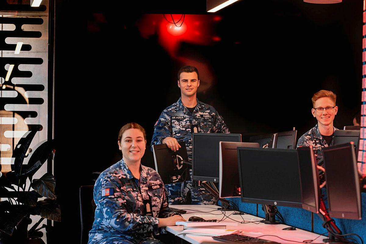 Air Force Officer Cadets Josephine Curtis, left, William Farrell and Elliot Parker, from the Australian Defence Force Academy, are training to become cyber security officers. Photo: Leading Aircraftman Adam Abela