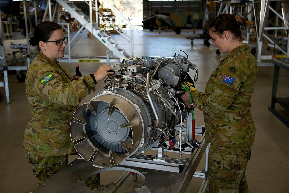 Corporal Shayna Antonio, left, and Sergeant Phillipa Finlay conduct an inspection on an MRH-90 Taipan engine at the Army Aviation Training Centre, Oakey, Queensland. Photo: Mary McKenzie