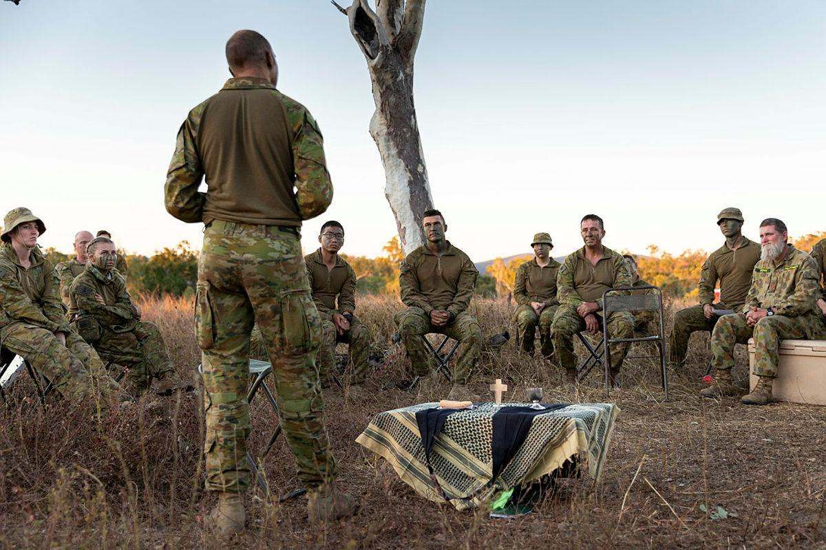 Chaplain Gary Pope,  of the 3rd Brigade Headquarters, delivers a field service to soldiers during Exercise Talisman Sabre at Townsville Field Training Area, Queensland. Photo: Corporal Brendon Grey