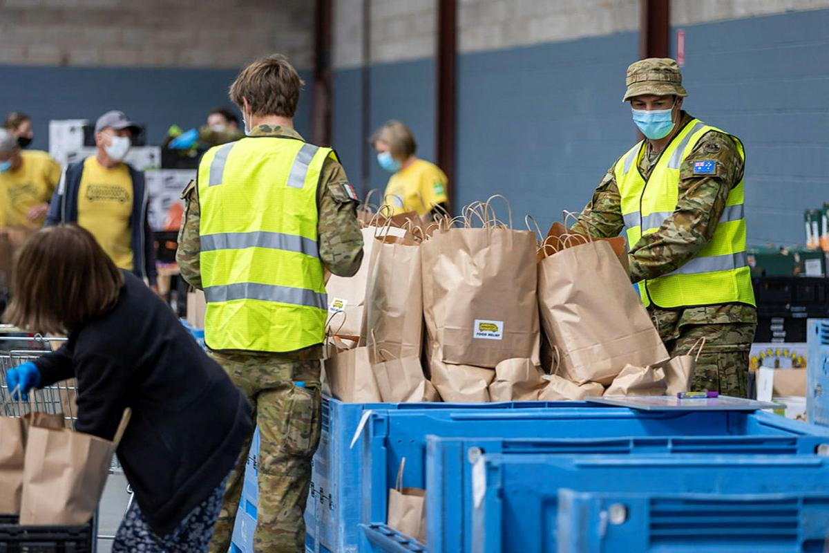 Army personnel and OzHarvest volunteers prepare dry and fresh food hampers in the OzHarvest warehouse at Alexandria, Sydney, a part of Operation COVID-19 Assist. Photo: Corporal Dustin Anderson