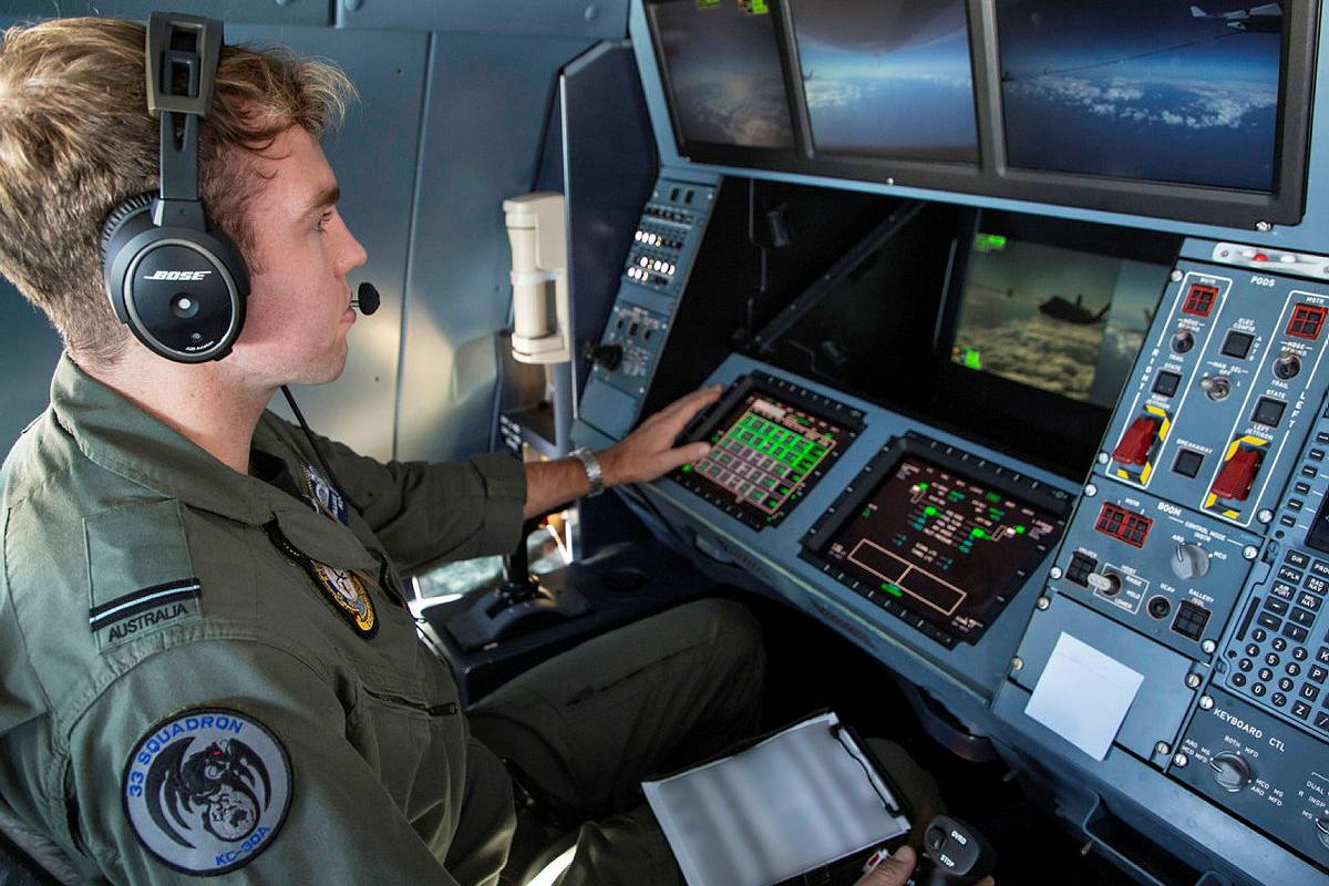Flying Officer William Delchau, from No. 33 Squadron, supervises an air-to-air refuelling sortie on board a KC-30A multi-role tanker transport aircraft during Exercise Talisman Sabre 2021. Photo: Sergeant Ben Dempster