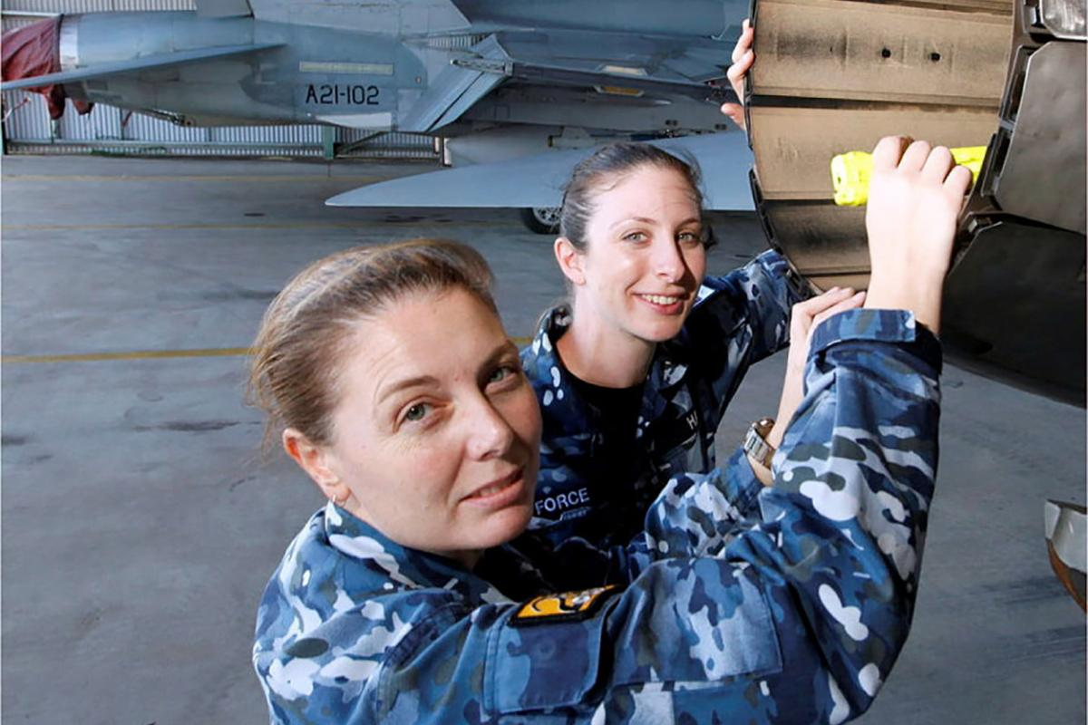 Wing Commander Shannan Forrest, left, in a file photo discussing the engineering characteristics of the F/A-18A Hornet engine exhausts. Photo: Sergeant Rob Mitchell